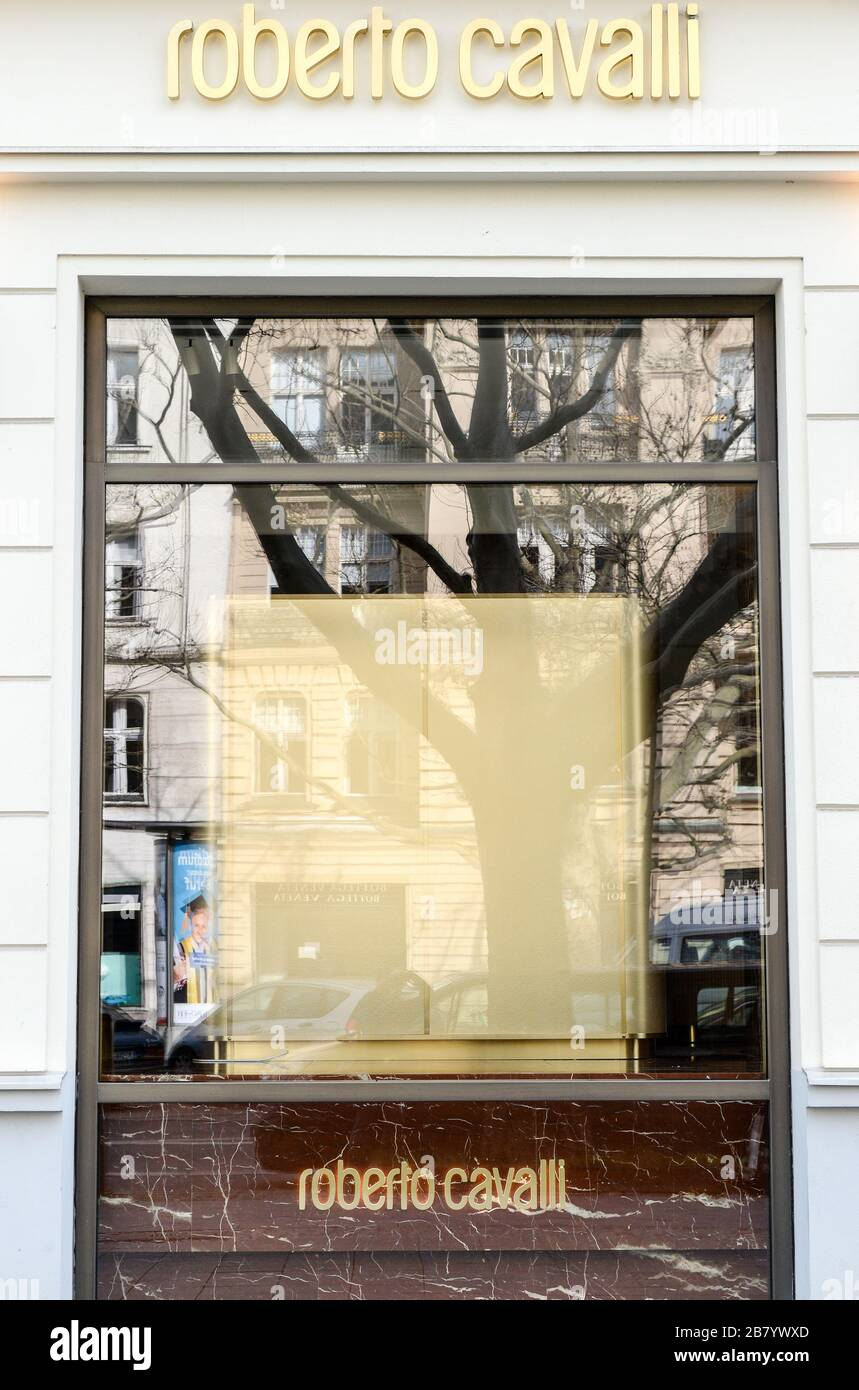 Berlin, Germany. 18th Mar, 2020. A luxury boutique on Kurfürstendamm, which is closed due to the Corona ededemie, has partially covered its shop windows and removed its products. Credit: Jens Kalaene/dpa-Zentralbild/ZB/dpa/Alamy Live News Stock Photo