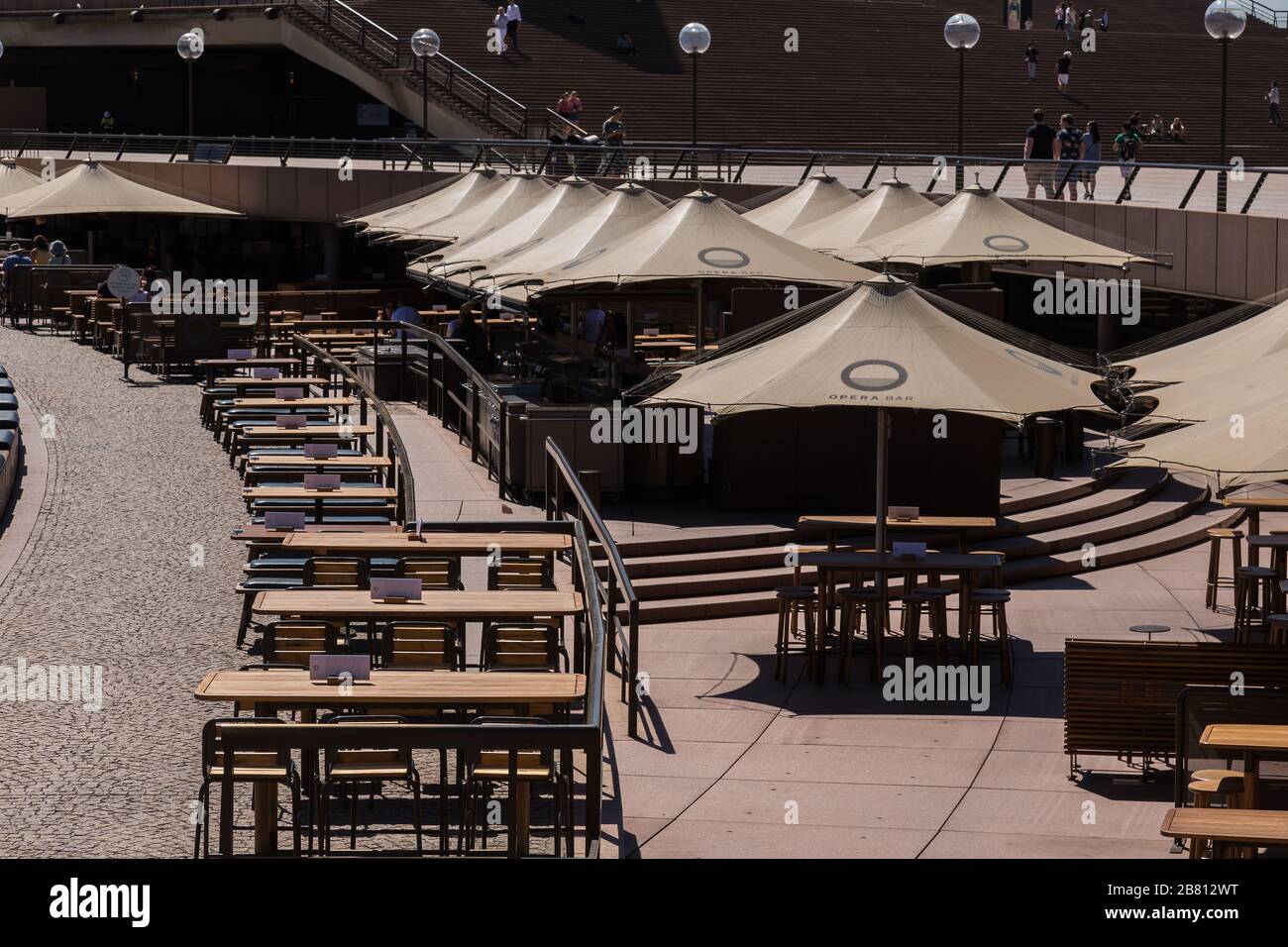 Opera Bar, Circular Quay, in Sydney's Central Business District is very empty as a result of the Coronavirus Outbreak, with very few customers aroun Stock Photo