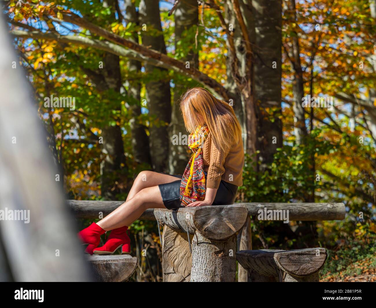 Stalking alone lonesome teen girl aka young woman outdoors outside in nature natural environment park Stock Photo