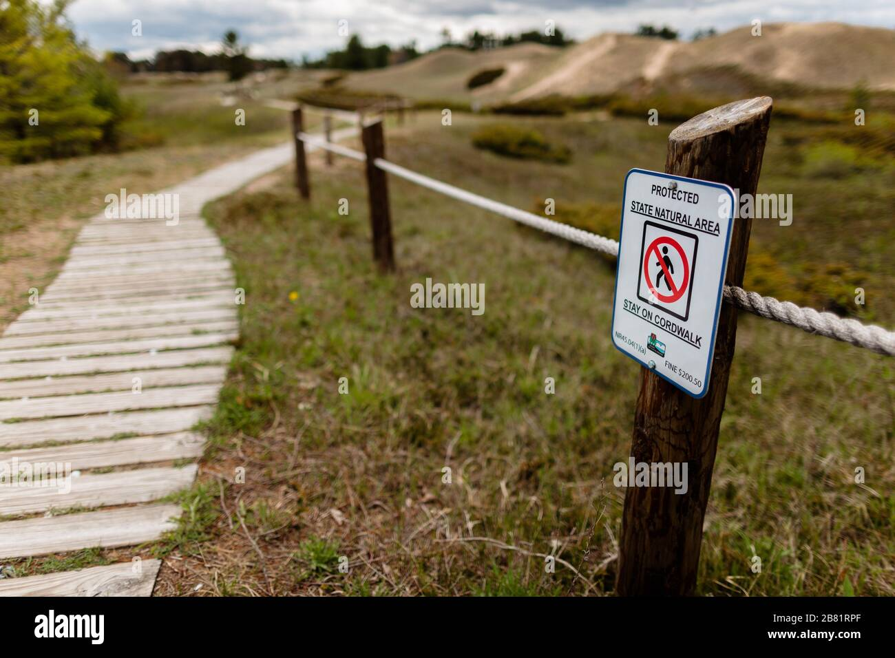 """Protecting the sand dunes at Kohler-Andrae State Park, Sheboygan, Wisconsin, with the roped-off area and the sign """"Protected State Natural Area,  Stay Stock Photo"""