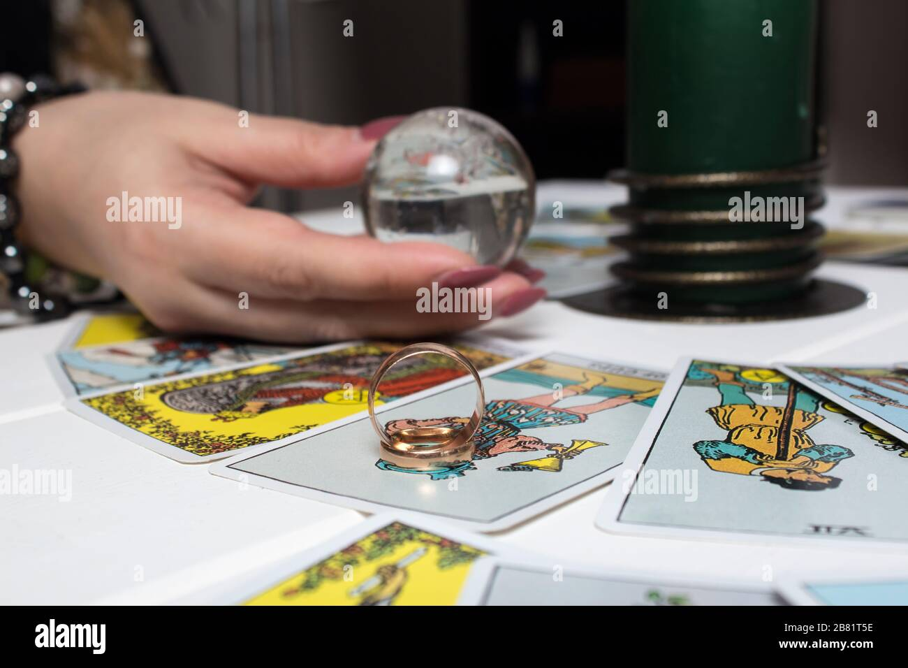 Bangkok, Thailand, March.15.20.Wedding rings are on Tarot cards. The Gypsy lays out Tarot cards and guesses for the future. Magic sessions with talkin Stock Photo