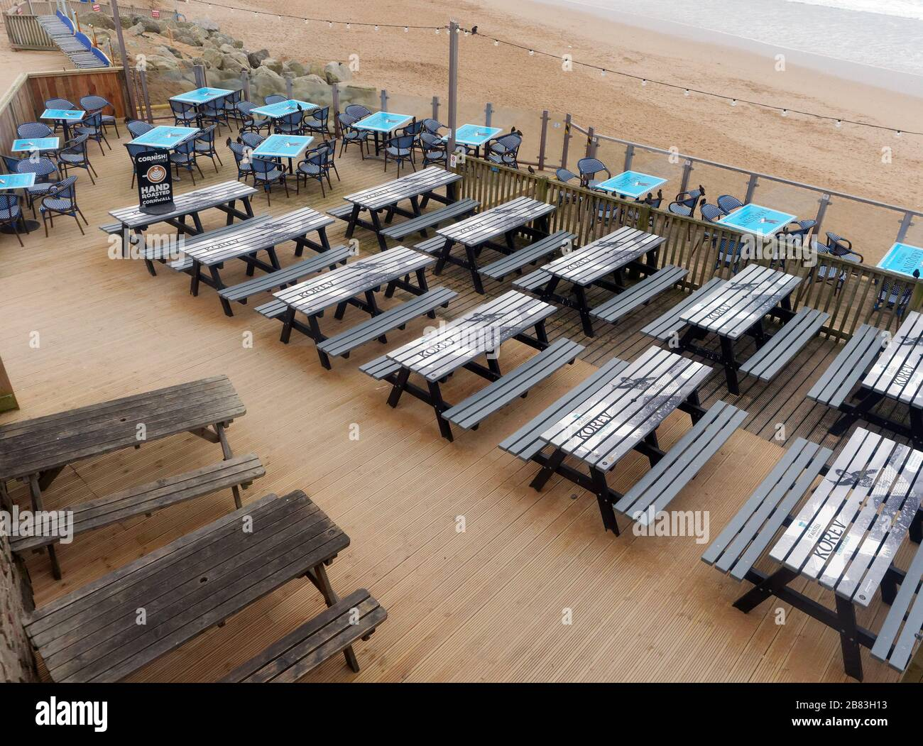 UK Weather, 19th March 2020. UK Fistral beach Newquay Cornwall. bars cafes and amusement arcades left deserted as public heed advice to stay away. Cre Stock Photo