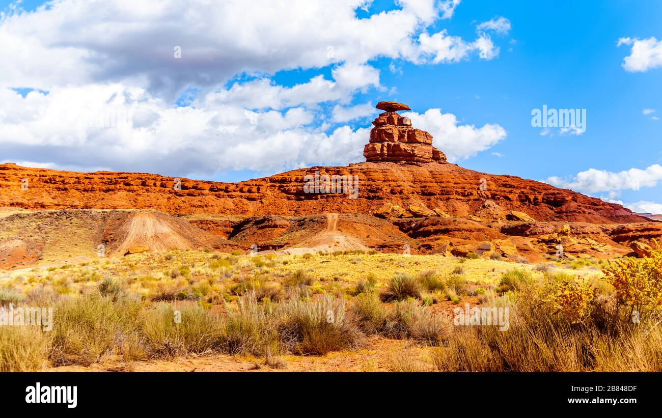 The sombrero-shaped rock outcropping on the northeast edge of the town named Mexican Hat, Utah, USA Stock Photo