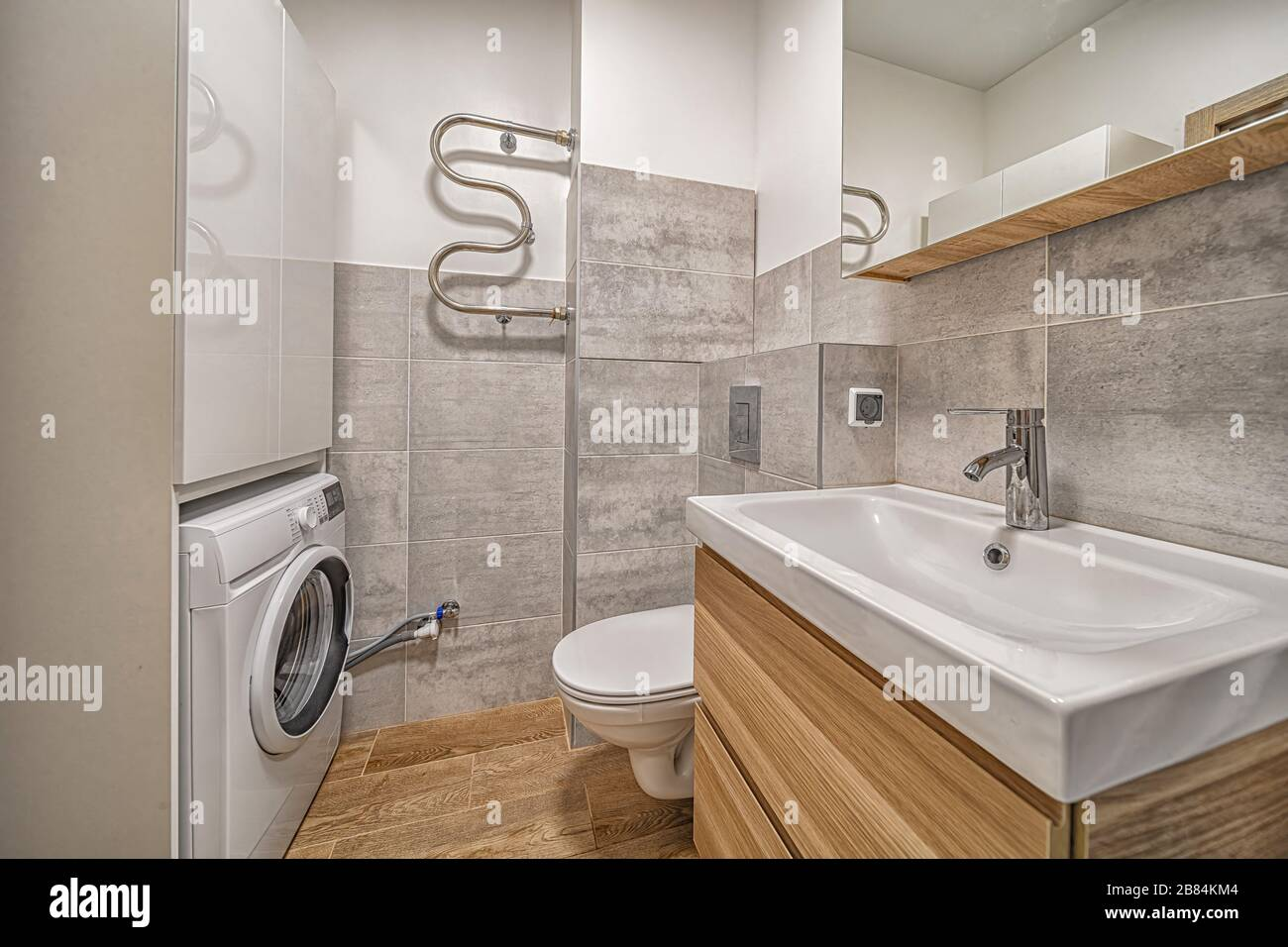 Tiny Modern Bathroom With Toilet Sink Mirror Washing Machine And Cabinet Contemporary Interior Design Stock Photo Alamy