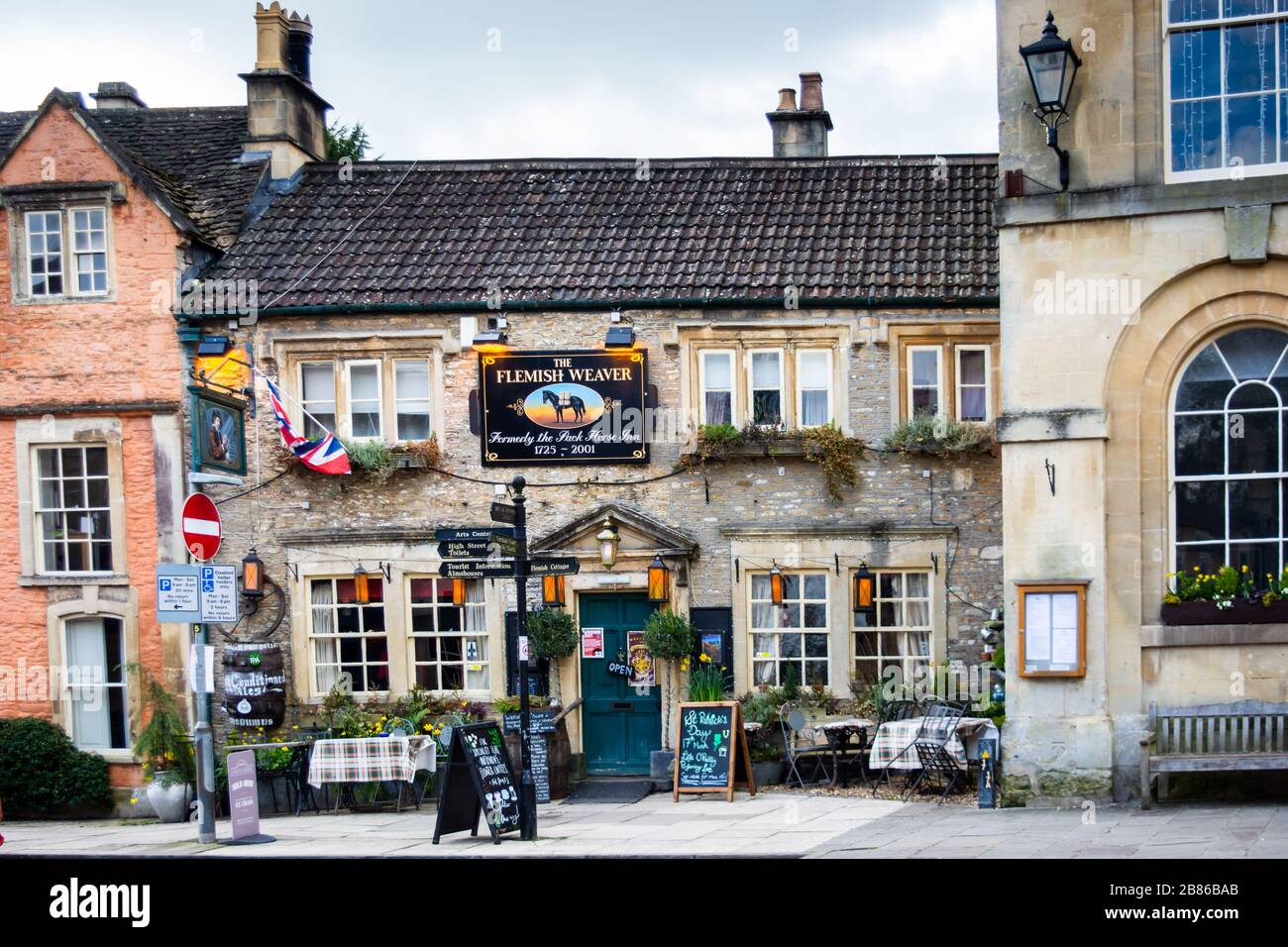 The Flemish Weaver  pub in Corsham Wiltshire with a sign declaring it was formally the Pack Horse Inn from 1725 to 2001 Stock Photo