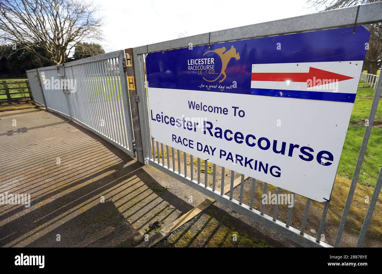 A general view of the locked gates at Leicester Racecourse as racing in Britain is on hold until the end of April at the earliest. Stock Photo