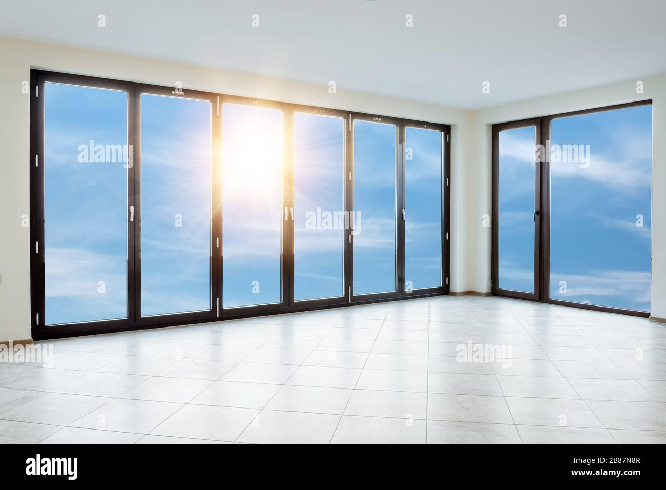 Empty white room with windows Stock Photo