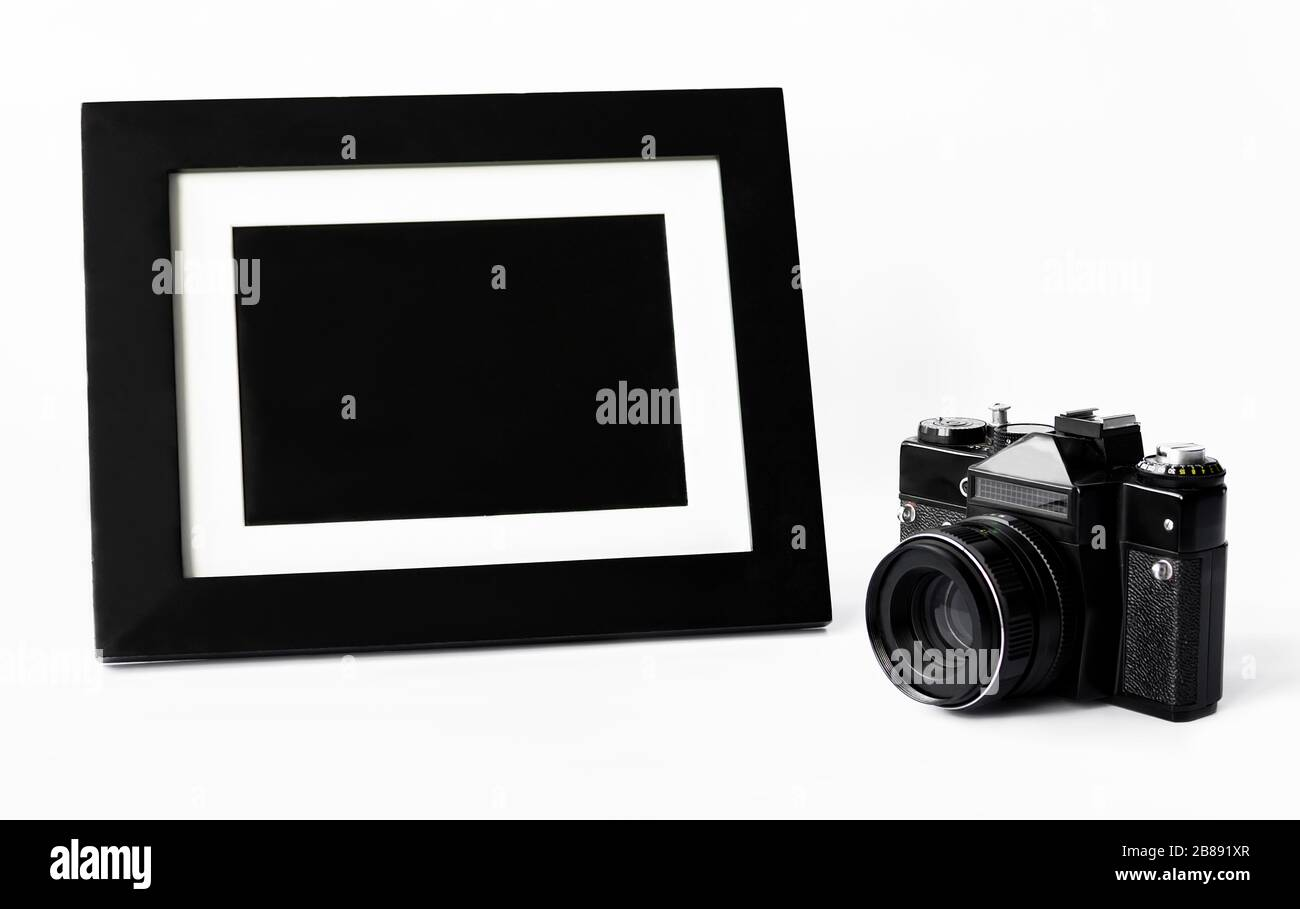 camera and photo frame on a white background, close up Stock Photo