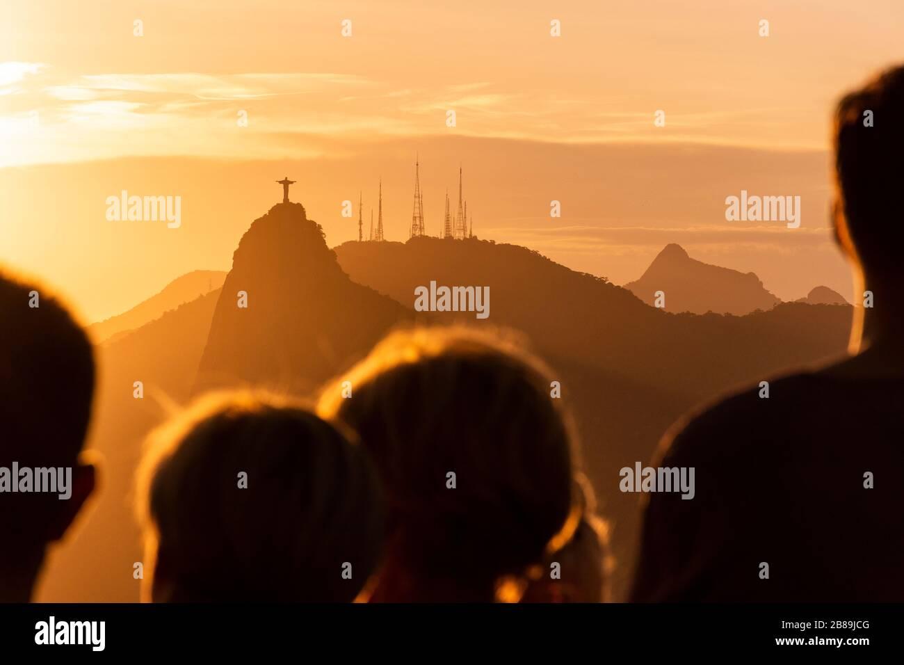 Beautiful view of tourists watching the sunset from Sugar Loaf Mountain, Rio de Janeiro, Brazil Stock Photo
