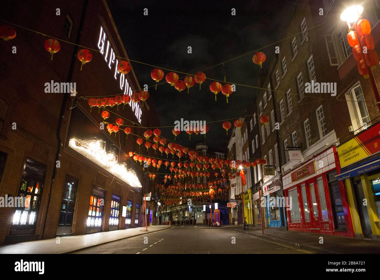 London, UK. 21st March 2020. Empty streets of Chinatown just after midnight on Saturday.  The government advises staying at home and limiting social life. Stock Photo