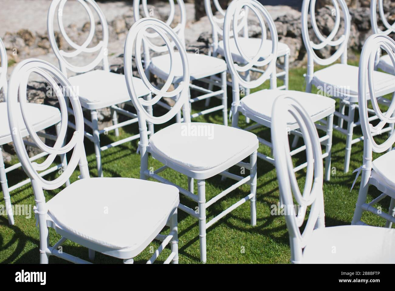White Chair Decorating For A Wedding Ceremony On A Green Lawn Stock Photo Alamy