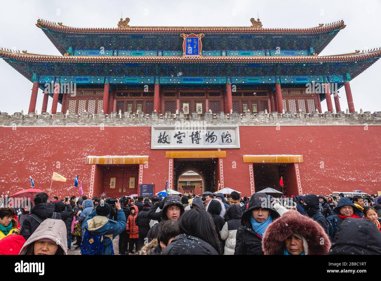 Tourists in front of Shenwumen - Gate of Divine Prowess also called Gate of Divine Might - northern gate of Forbidden City in Beijing, China Stock Photo