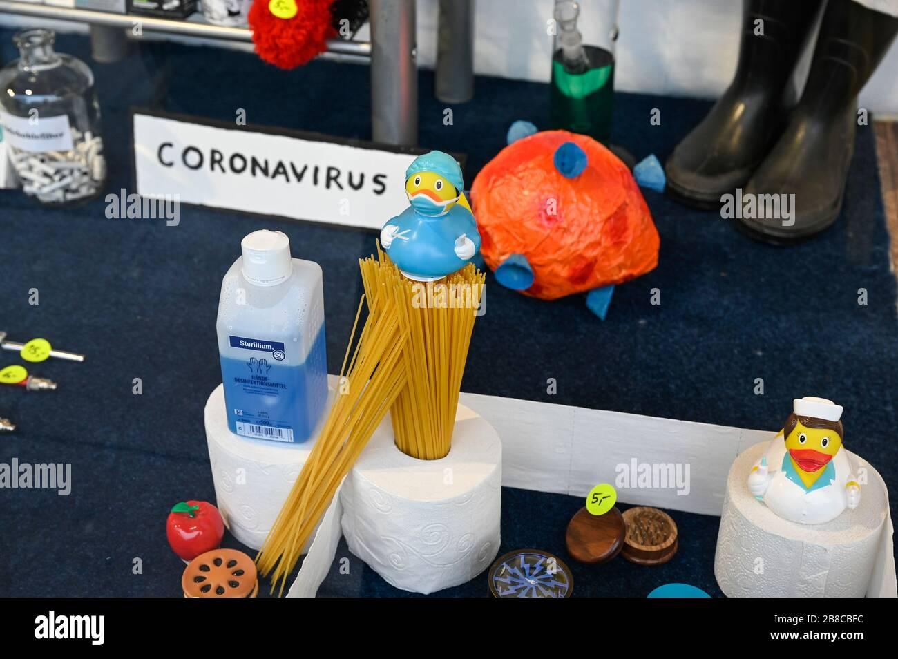 GERMANY, Hamburg, Corona Virus, COVID-19 , corona theme shopping window of a closed shop on reeperbahn, St. Pauli district, rare items during Hamster purchase: antiseptics, noodle, toilet paper Stock Photo