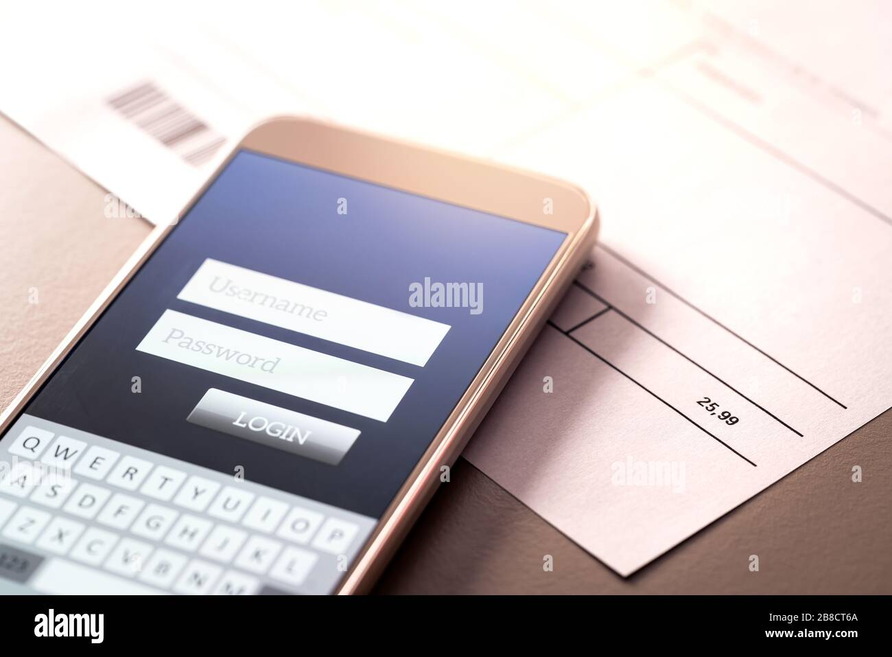 Phone bill and smartphone with online bank app. Electricity, energy, utilities or gas invoice on table with mobile smart device for internet payment. Stock Photo