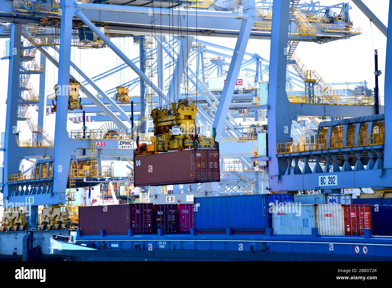 Rotterdam, The Netherlands - August 2019; image filling view on the inner structure with beams and booms of numerous gantry cranes moving containers i Stock Photo