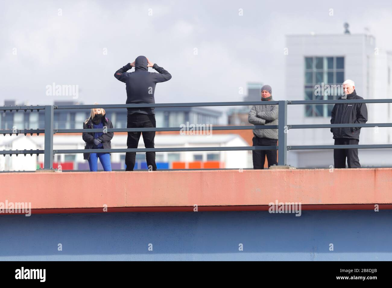 A man who threatened to throw himself off a bridge in Leeds, is seen speaking to negotiators, who managed to talk him to safety after 4 hours Stock Photo