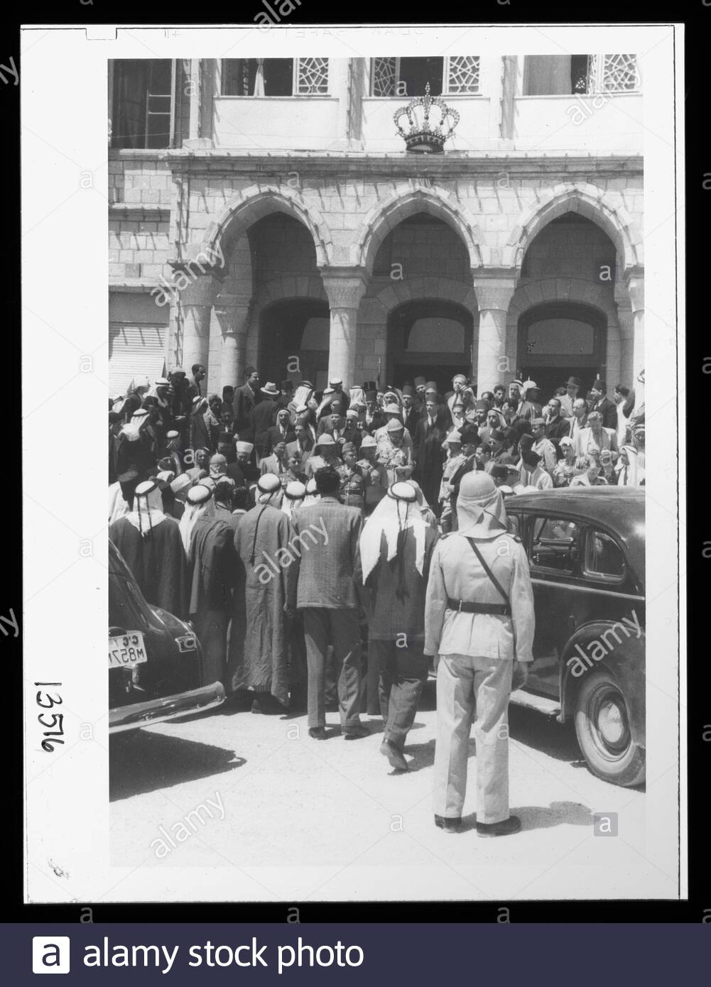 """English: Title: 'Coronation' of King Abdullah in Amman. Crowds at palace awaiting king's return from the mosque Abstract/medium: G. Eric and Edith Matson Photograph Collection  Physical description: 1 transparency :; 1946; Library of Congress Catalog: https://www.loc.gov/pictures/collection/matpc/item/mpc2005010235/PP Original url: https://hdl.loc.gov/loc.pnp/matpc.14991; Matson Collection; "" Stock Photo"