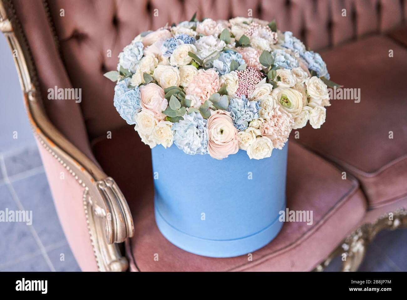 Bouquet Of Beautiful Mixed Flowers In Blue Box European Floral Shop Floral Bunch In Round Box Excellent Garden Flowers In The Arrangement The Stock Photo Alamy
