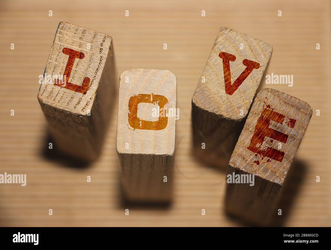 Love word on wooden blocks. Love romance devotion concept Stock Photo