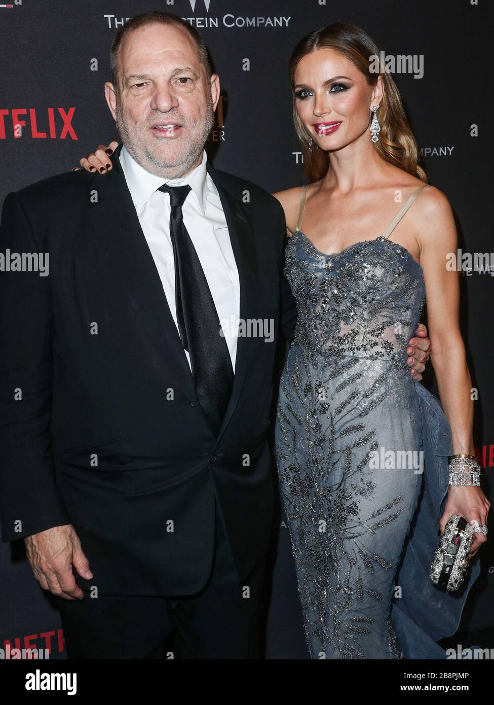 (FILE) Harvey Weinstein Tests Positive for Coronavirus COVID-19. Harvey Weinstein Tests Positive For Coronavirus In New York State Prison. Convicted Producer In Isolation. BEVERLY HILLS, LOS ANGELES, CALIFORNIA, USA - JANUARY 08: American film producer Harvey Weinstein and wife/fashion designer Georgina Chapman arrive at The Weinstein Company and Netflix Golden Globe Party, presented with FIJI Water, Grey Goose Vodka, Lindt Chocolate, and Moroccan Oil held at The Beverly Hilton Hotel on January 8, 2017 in Beverly Hills, Los Angeles, California, United States. (Photo by Xavier Collin/Image Pres Stock Photo