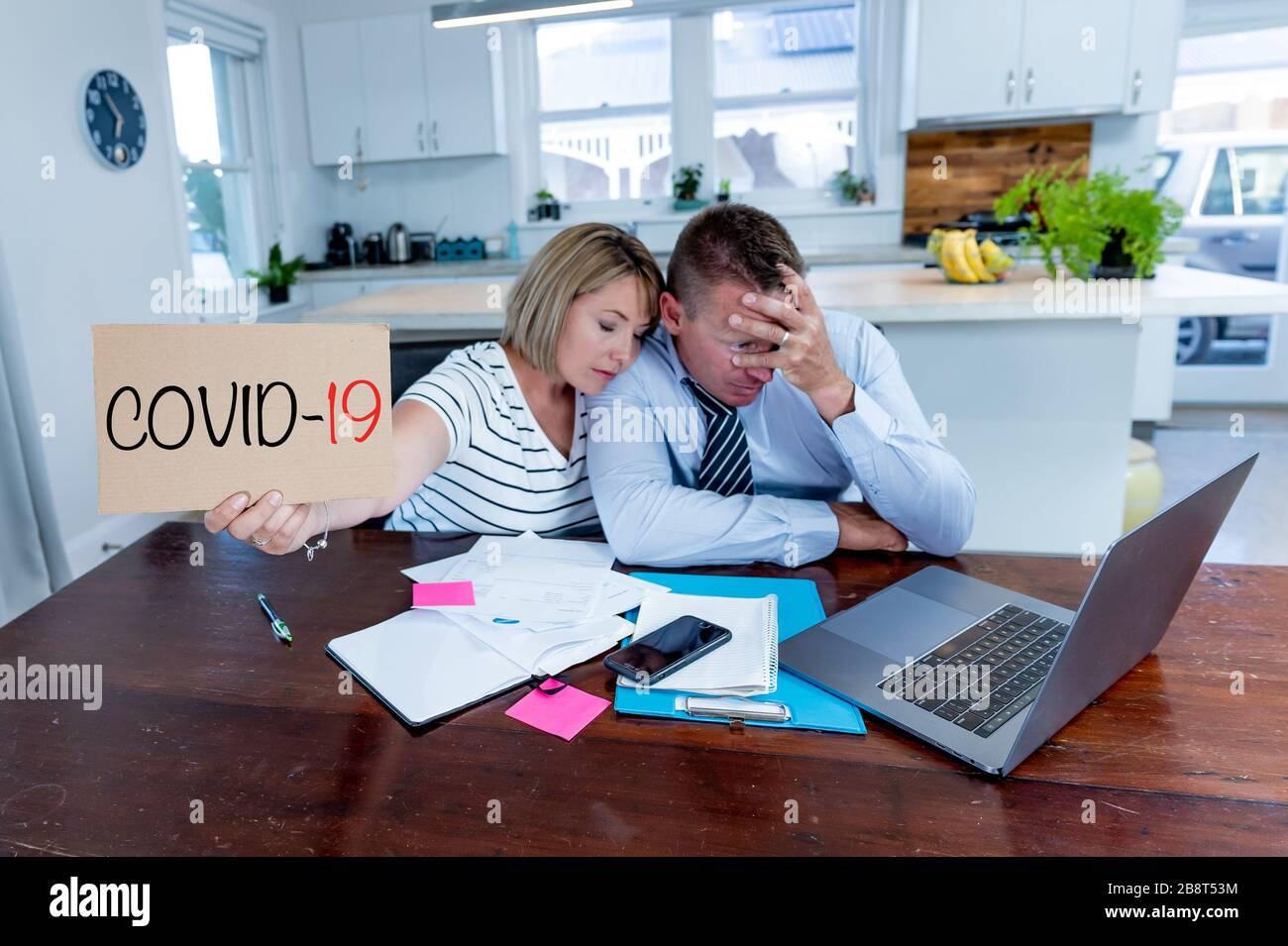 Coronavirus economic recession. Family couple in distress of job losses worried about bills, credit debts, loans and home finances. Impact of COVID-19 Stock Photo