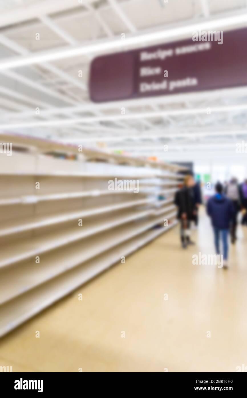 Blurred interior background image of empty supermarket shelves due to Covid-19, Coronavirus, induced stockpiling Stock Photo