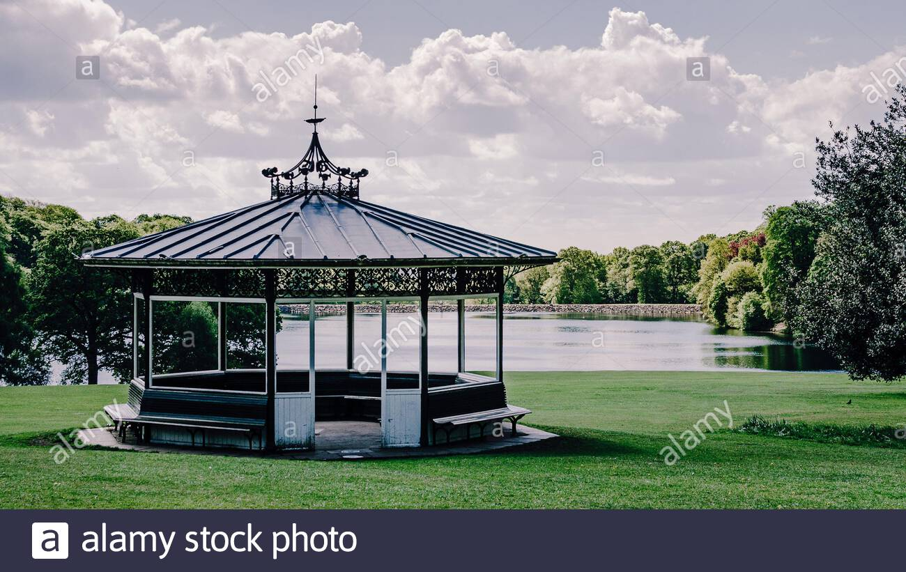 Beautiful Victorian bandstand in Roundhay public park city of Leeds, Yorkshire with Waterloo lake background Stock Photo