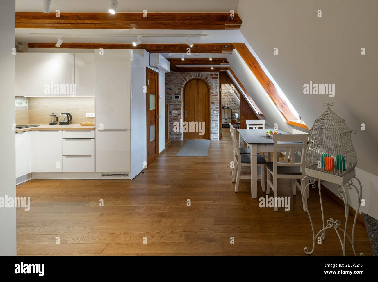 Modern Wooden Loft Interior Of Apartment Entrance Hall White Kitchen Set Brick Wall Private House Table And Chairs Stock Photo Alamy