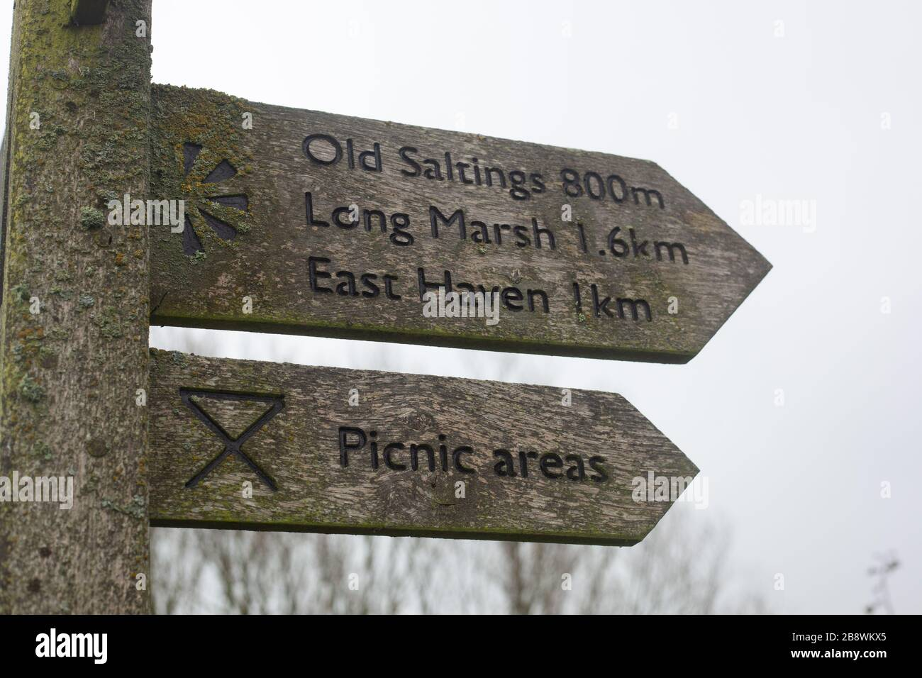 Direction sign providing guidance to walkers and ramblers to the Old Saltings, Long Marsh, East Haven and Picnic areas at Bowers Gifford, Essex, UK Stock Photo