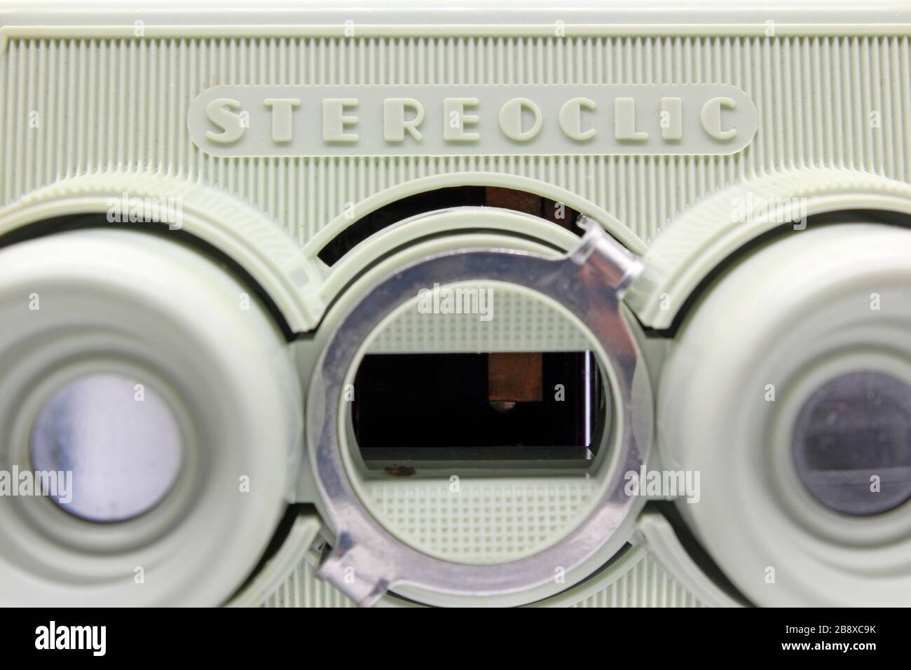 Vintage stereoscopic slide viewer, front view, isolated on white background, close-up Stock Photo