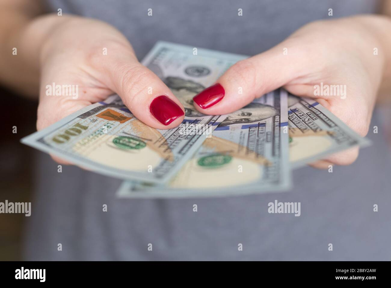 US Dollars banknotes. Money in a woman's hand. Lack of money. Unemployed. unemployment. Financial crisis. Credit. Loan. Stock Photo