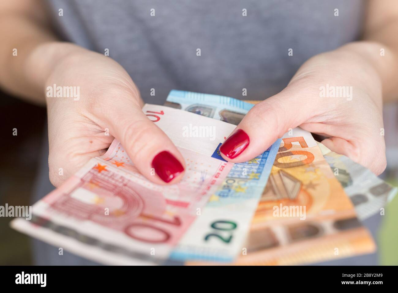 Euro banknotes. Money in a woman's hand. Lack of money. Unemployed. unemployment. Financial crisis. Credit. Loan. Stock Photo