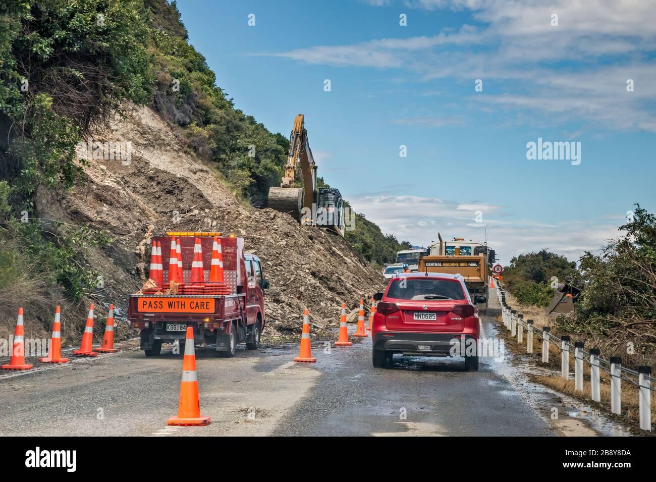 Road emergency repairs due to torrential rain landslide on Makarora Lake Hawea Road, Otago Region, South Island, New Zealand Stock Photo