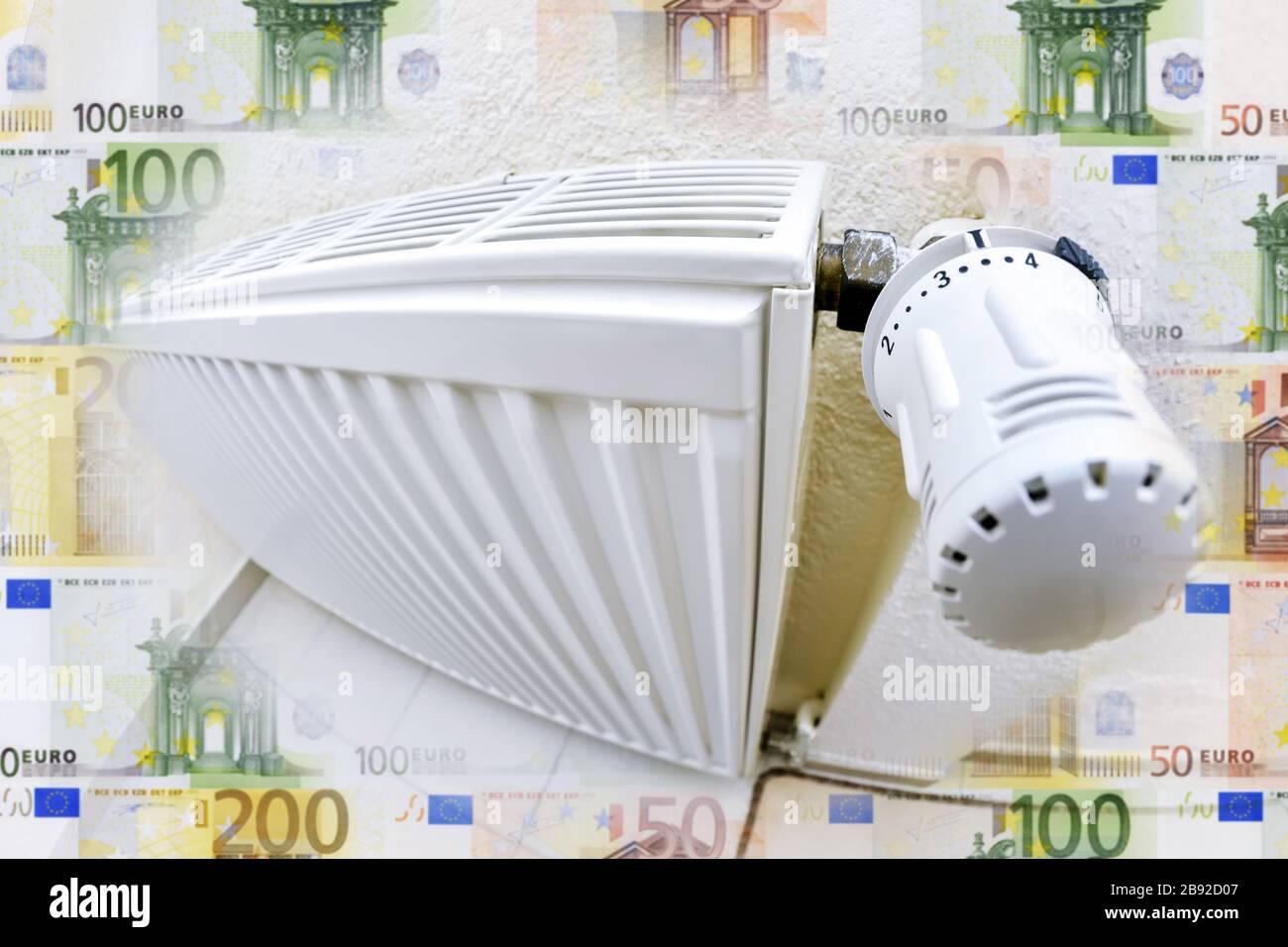 PHOTOMONTAGE, heating and bank notes, heating costs, FOTOMONTAGE, Heizung und Geldscheine, Heizkosten Stock Photo