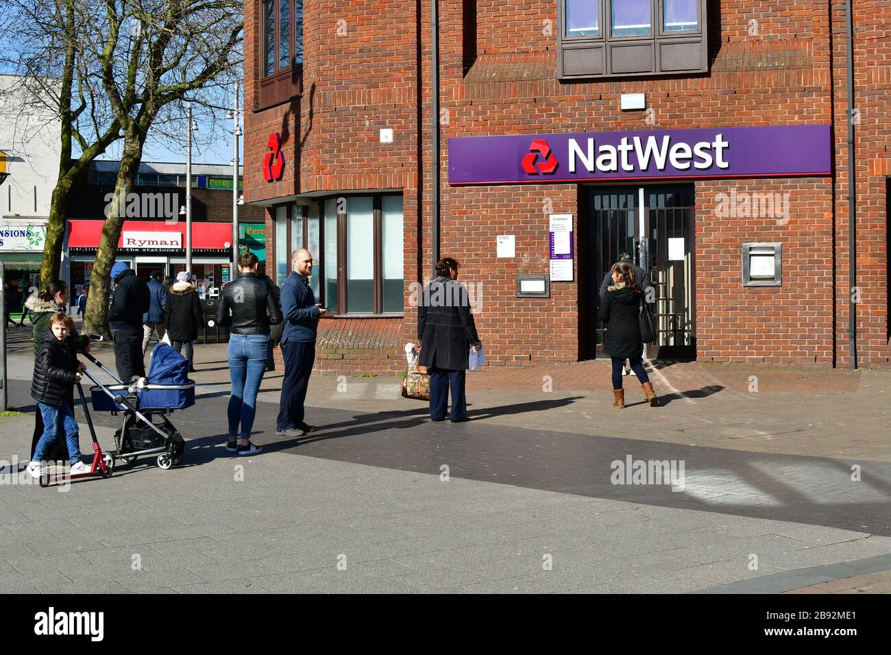 London, UK. 23 Mar, 2020. Coronavirus threat - People queue outside NatWest Bank only allow one at a time to entry bank, on 23 March in Walthamstow, London, UK. Credit: Picture Capital/Alamy Live News Stock Photo