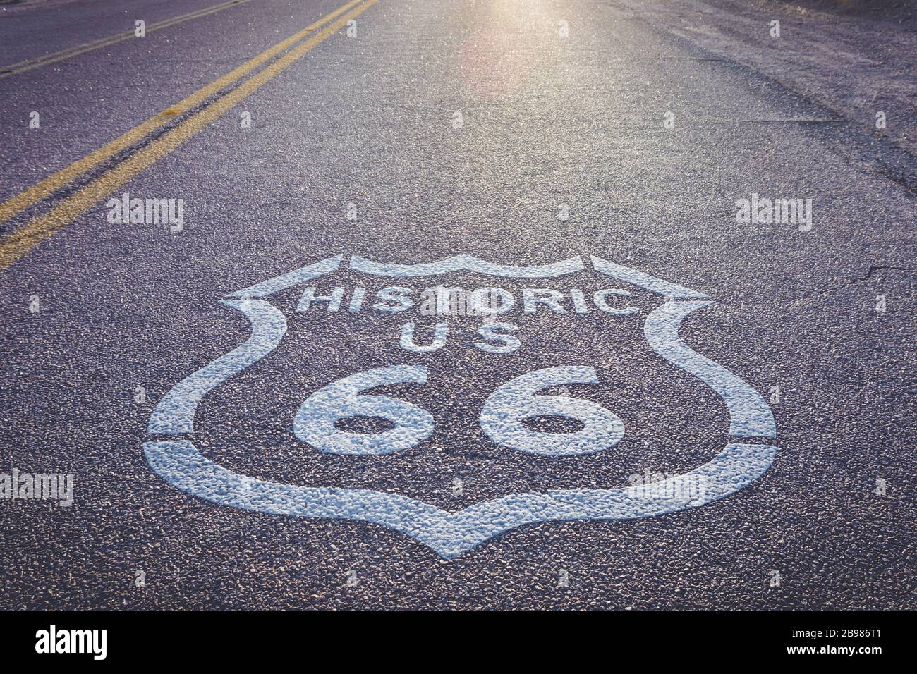 Historic US Route 66 highway sign on asphalt Stock Photo