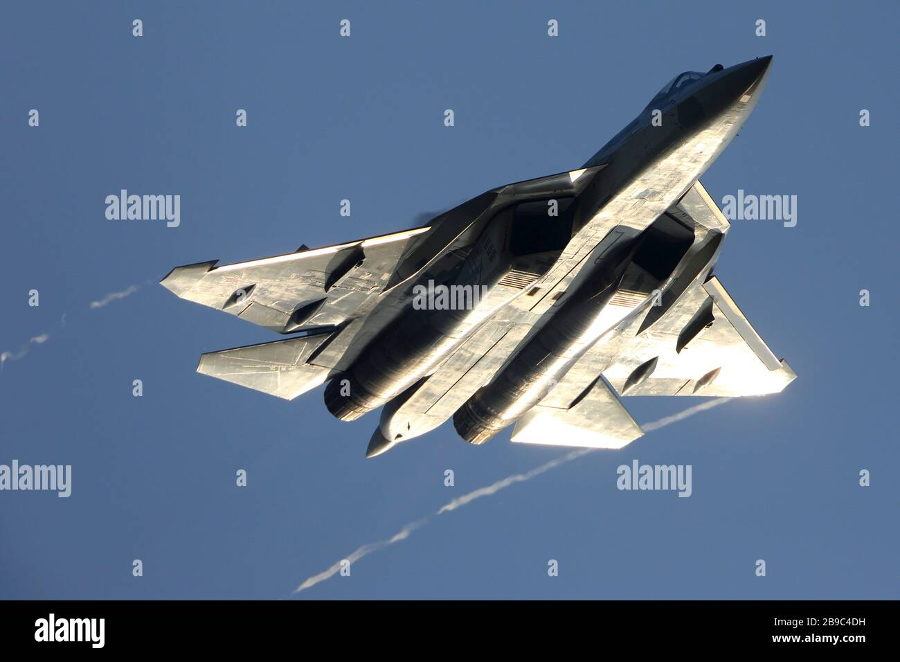 Su-57 jet fighter of the Russian Air Force against a blue sky. Stock Photo