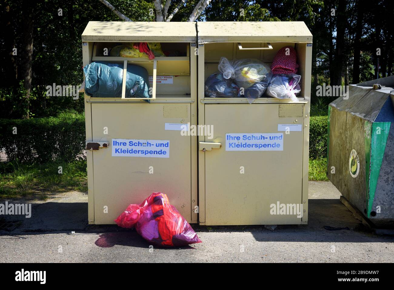 Old clothes container in Schleswig - Holstein, Altkleidercontainer in Schleswig-Holstein Stock Photo