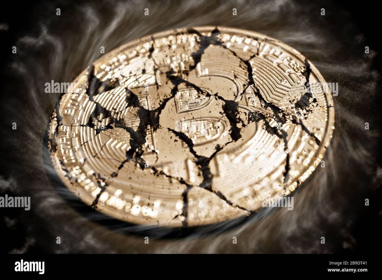 PHOTOMONTAGE, coin with Bitcoin sign and tears, FOTOMONTAGE, Münze mit Bitcoin-Zeichen und Rissen Stock Photo