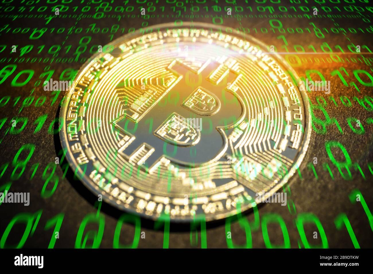 PHOTOMONTAGE, coin with Bitcoin sign and binary code, FOTOMONTAGE, Münze mit Bitcoin-Zeichen und Binärcode Stock Photo