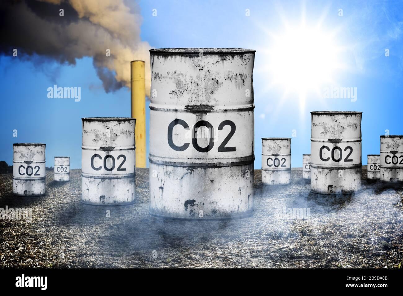 PHOTOMONTAGE, tonnes with label CO2, symbolic photo CO2-Bepreisung and CO2 tax, FOTOMONTAGE, Tonnen mit Aufschrift CO2, Symbolfoto CO2-Bepreisung und Stock Photo
