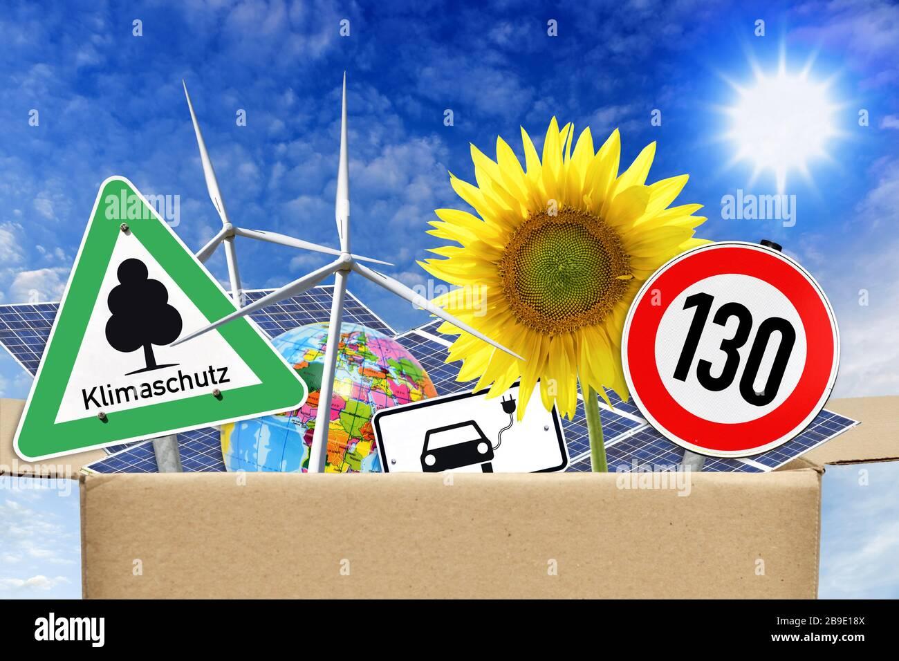 PHOTOMONTAGE, package with climate protection measures, FOTOMONTAGE, Paket mit Klimaschutzmaßnahmen Stock Photo