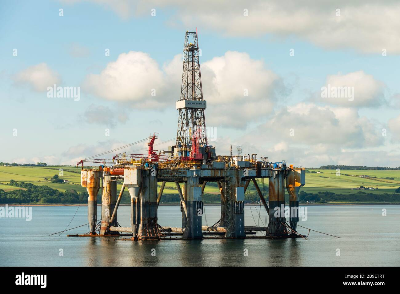 Ocean Nomad (1975), an offshore oil jackup drilling platform, lies decommissioned in the Cromarty Firth, Scotland, UK, 2016. Stock Photo
