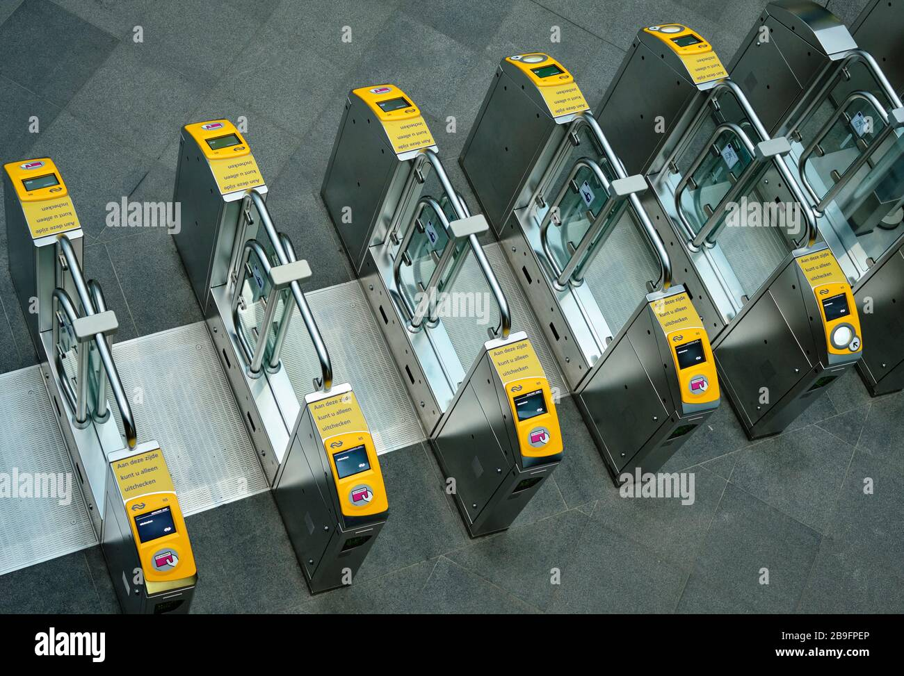 Acces gates where you can scan your card to get to the public transport facilities. Stock Photo