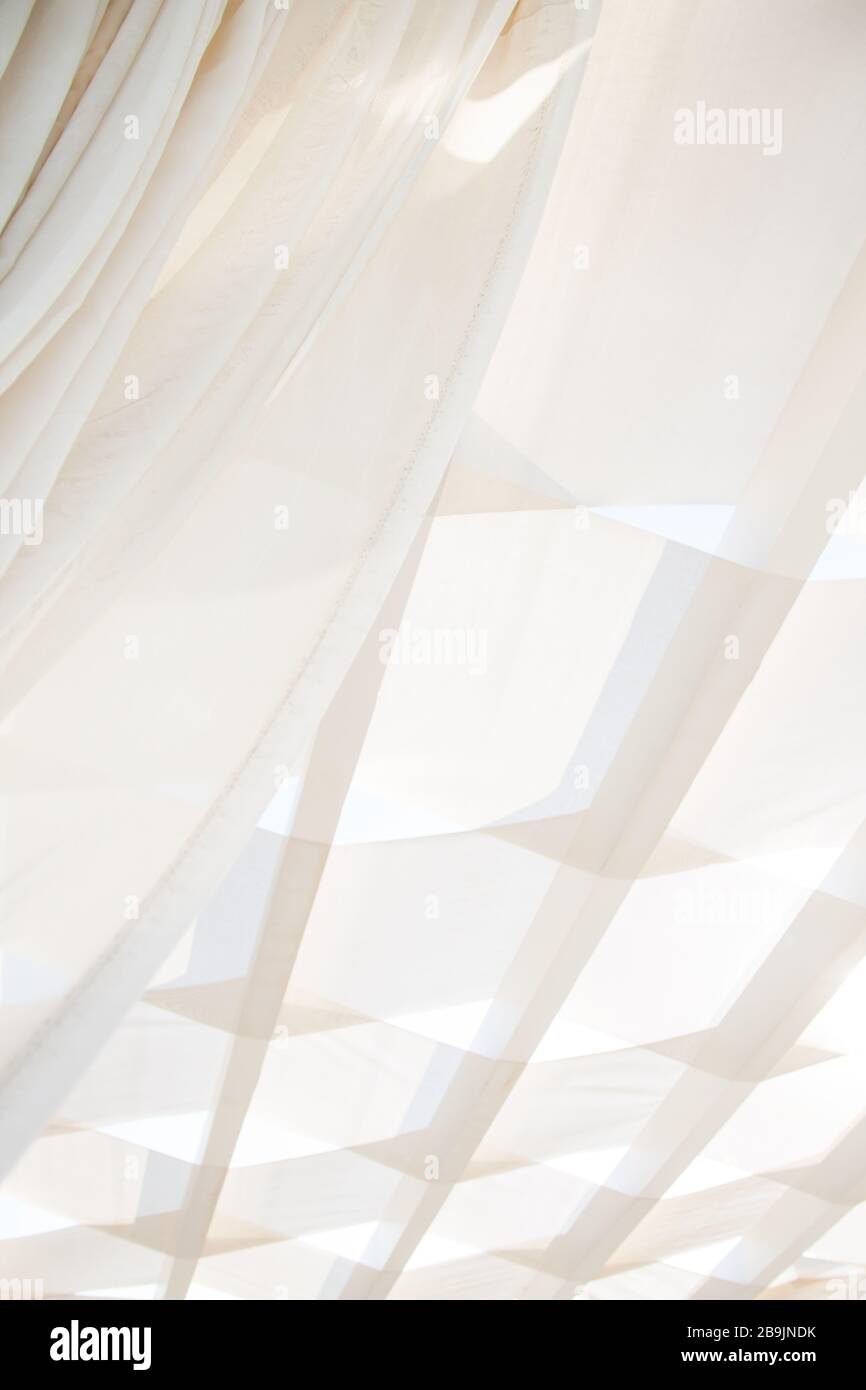 White Transparent Curtains and Shade Sail in El Gouna Egypt Stock Photo