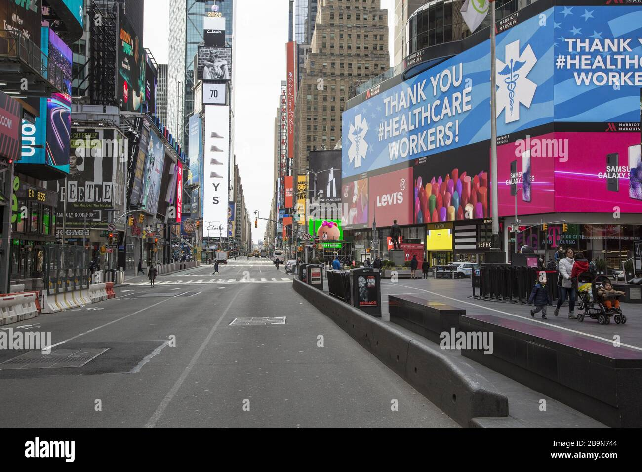 Times Square is virtually empty of tourists and New Yorkers due to the Coronavirus and the state lockdown in New York. Stock Photo