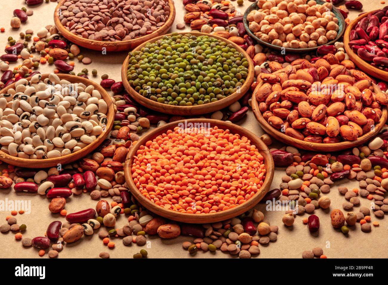 Legumes Assortment On A Brown Background Lentils Soybeans Chickpeas Red Kidney Beans A Vatiety Of Pulses Stock Photo Alamy