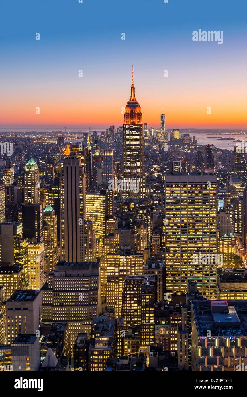 Midtown Manhattan skyline with Empire State Building at dusk, New York, USA Stock Photo