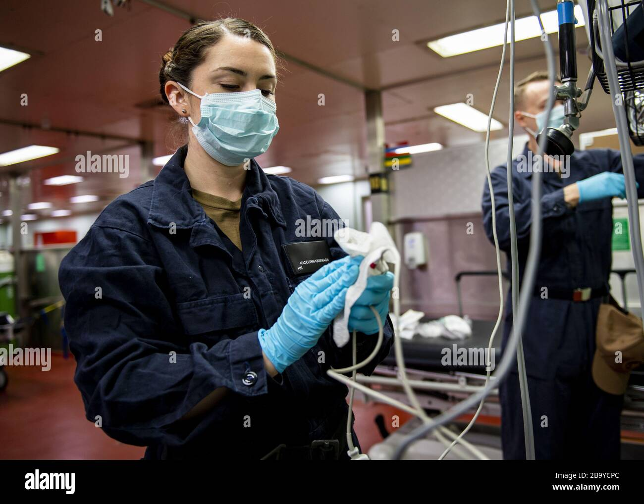 Los Angeles, California, USA. 25th Mar, 2020. Hospitalman Katelynn Kavanagh, from Temecula, Calif., sanitizes medical equipment aboard the Military Sealift Command hospital ship USNS Mercy (T-AH 19) on March 24, 2020. Mercy deployed in support of the nation's COVID-19 response efforts, and will serve as a referral hospital for non-COVID-19 patients currently admitted to shore-based hospitals. This allows shore base hospitals to focus their efforts on COVID-19 cases. One of the Department of Defense's missions is Defense Support of Civil Authorities. DoD is supporting the Federal Emergency Mana Stock Photo