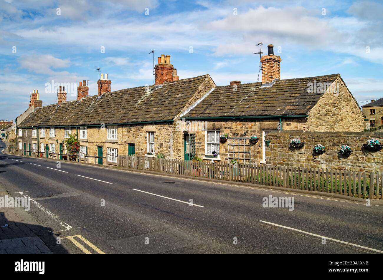 UK,South Yorkshire,Rotherham,Wentworth,Cottages next to B6090 Stock Photo